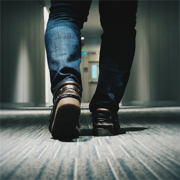 feet in hotel corridor